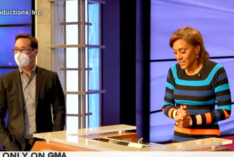 Mike Richards (left) talking with Robin Roberts (right) during her guest hosting time at Jeopardy!