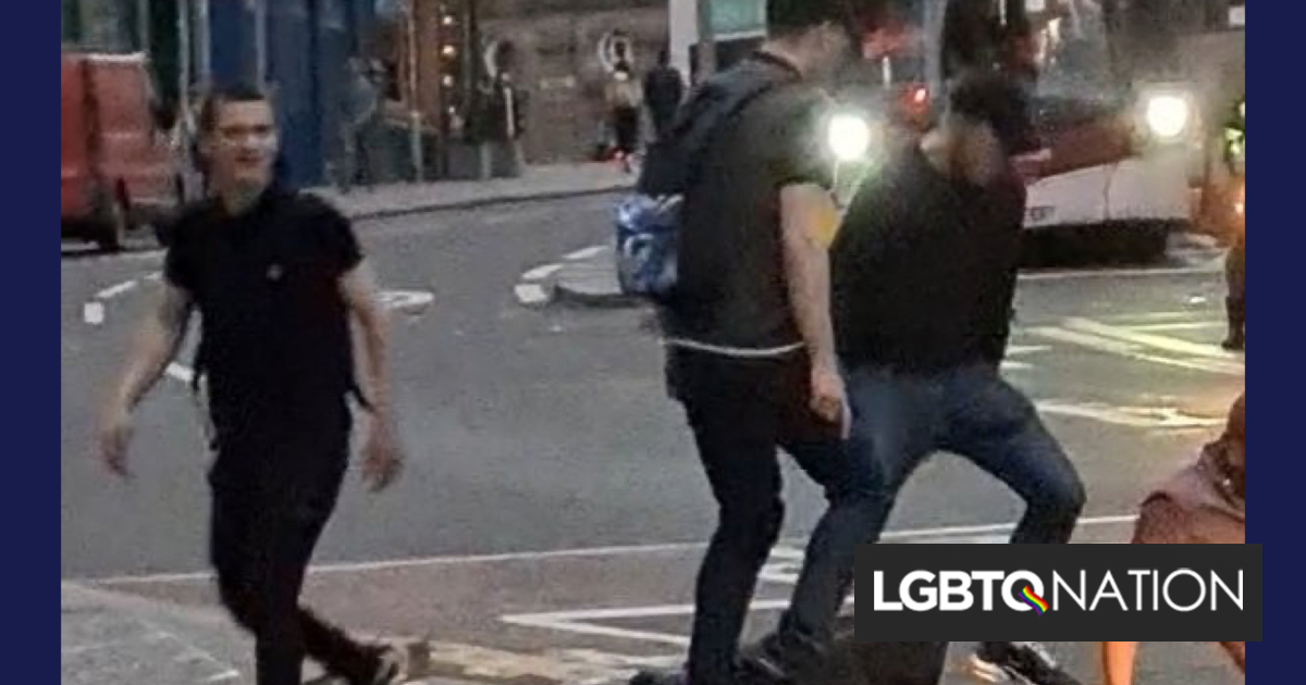 Group of men brazenly beat & rob a gay couple in the middle of a busy street