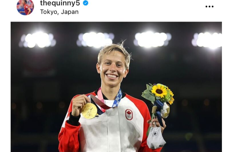 Quinn showing off their Olympic Gold medal.