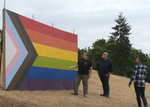 Residents build giant Pride flag in view of high school after school board bans it