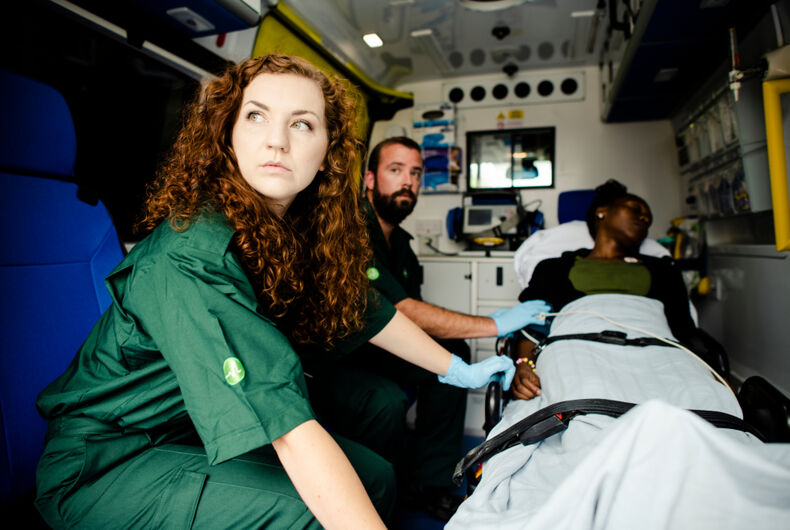 Ambulance with patient and EMTs