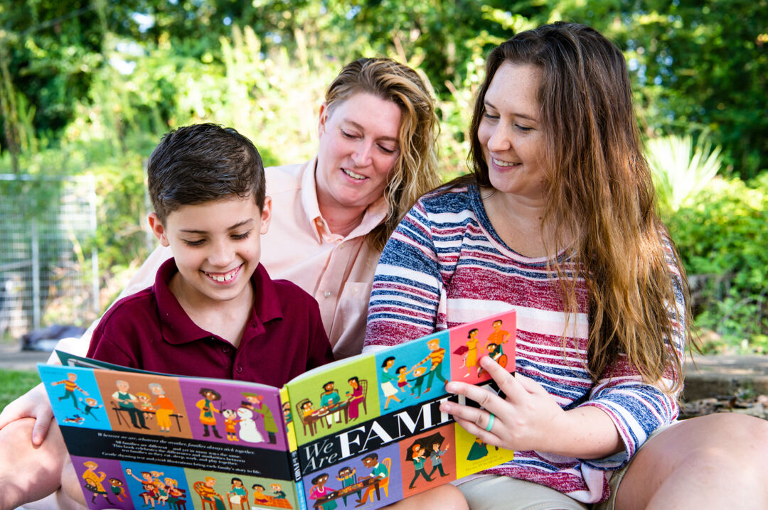 Two Moms Reading with Son