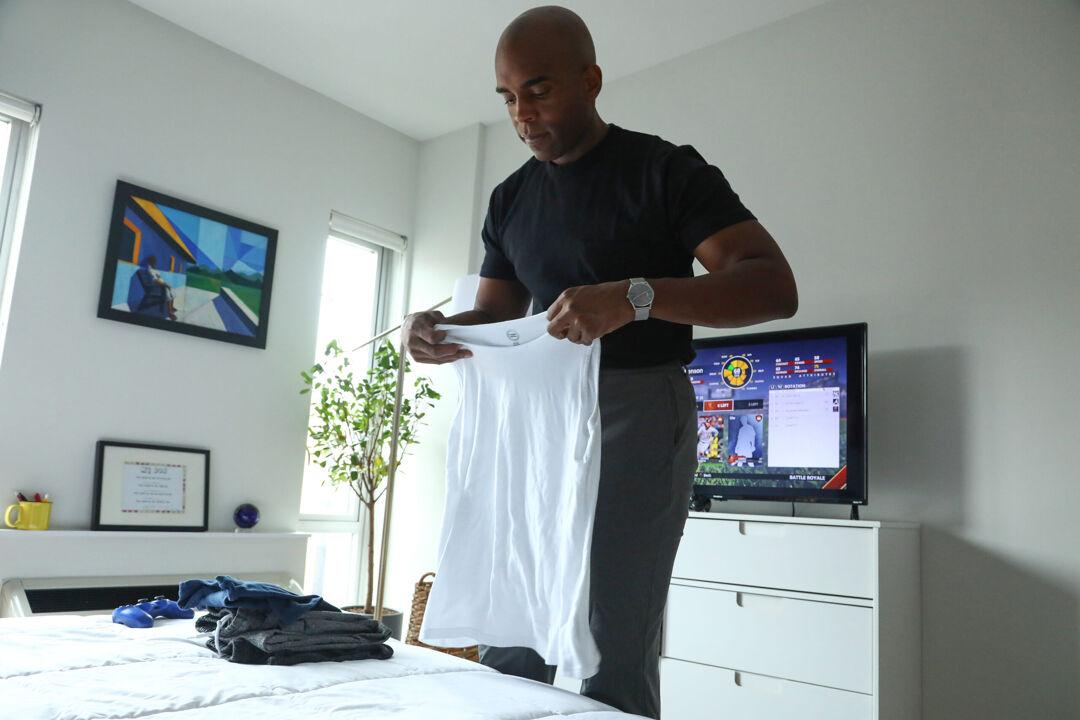 Chris Witherspoon folding laundry