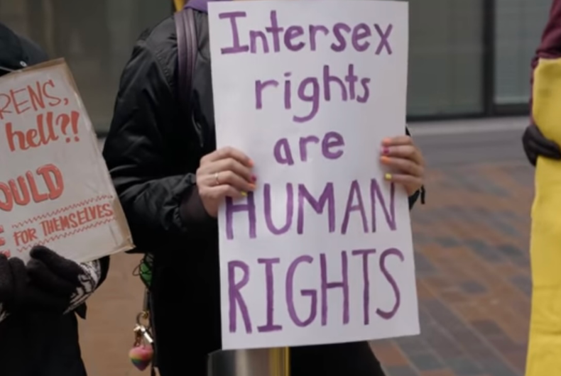 A protestor holding a sign, advocating for intersex rights outside a hospital in Chicago in 2019.