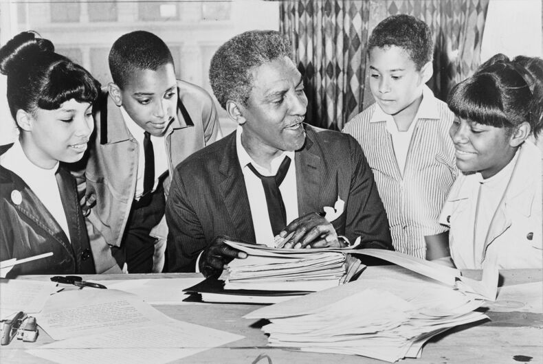 Bayard Rustin (center) speaking with (left to right) Carolyn Carter, Cecil Carter, Kurt Levister, and Kathy Ross, before demonstration / World Telegram & Sun photo by Ed Ford.