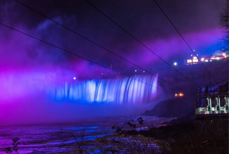 Niagara Falls lit in the colors of the Bisexual Pride Flag