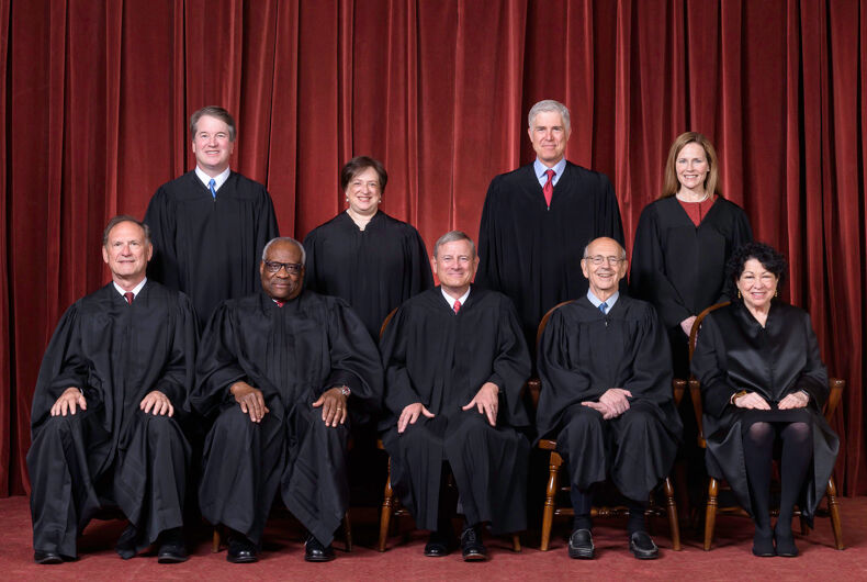 The Roberts Court on April 23, 2021 - seated from left to right: Justices Samuel A. Alito, Jr. and Clarence Thomas, Chief Justice John G. Roberts, Jr., and Justices Stephen G. Breyer and Sonia Sotomayor Standing from left to right: Justices Brett M. Kavanaugh, Elena Kagan, Neil M. Gorsuch, and Amy Coney Barrett.