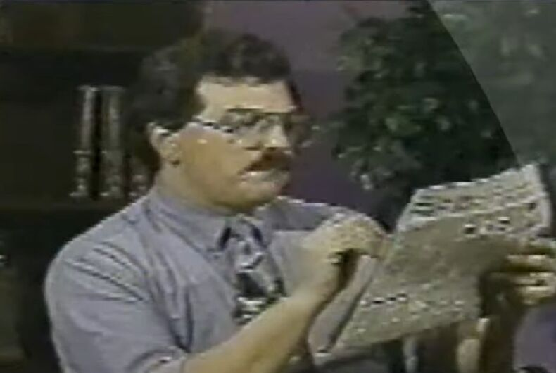Bob Enyart reading a newspaper during a Jan 9, 1995 broadcast.
