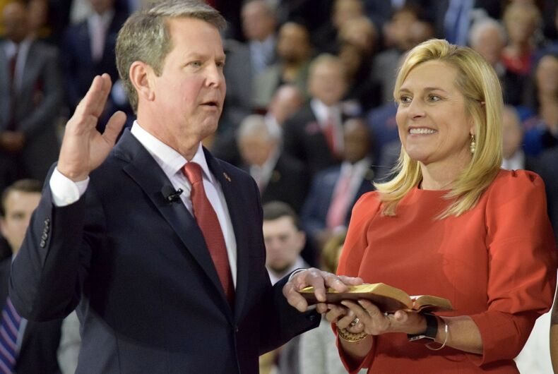 Brian Kemp being sworn in as governor with his wife Marty.