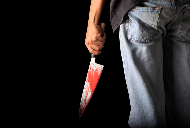 Person with bloody knife