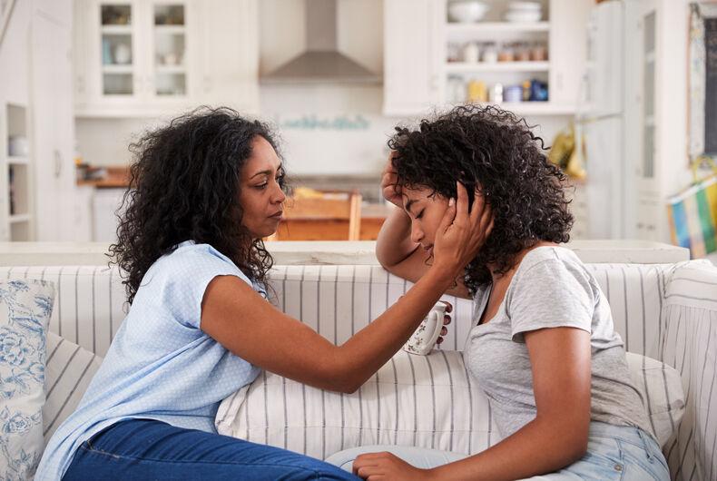 mother talking to sad daughter