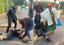 Gay teen beaten by mob as laughing bystander records the attack